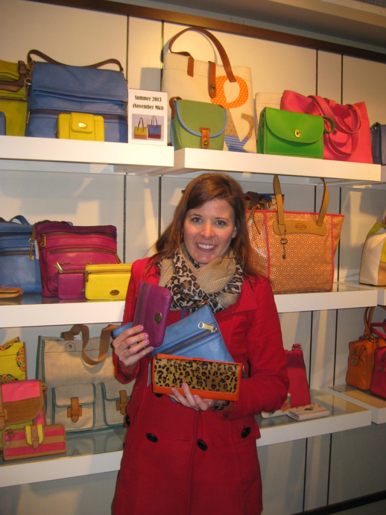 me-holding-up-fossil-purses
