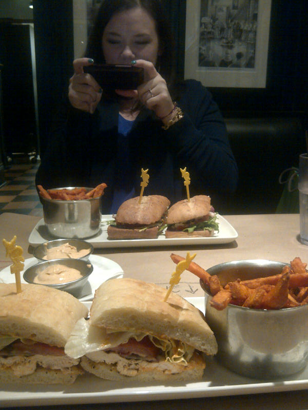 Leanne taking pics of food